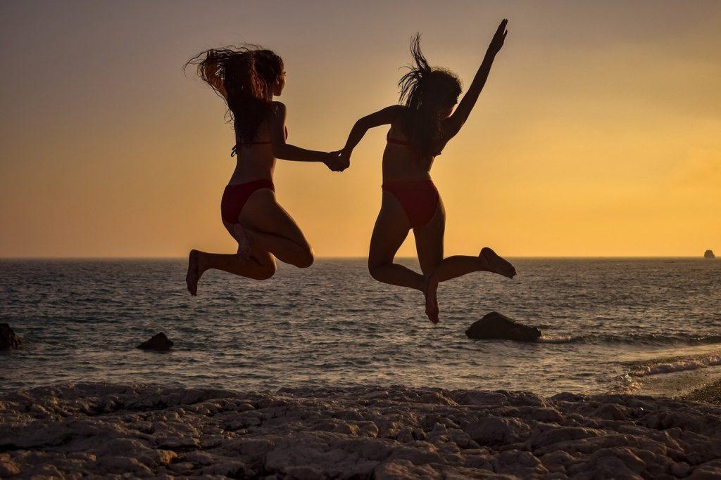girls, jumping, beach